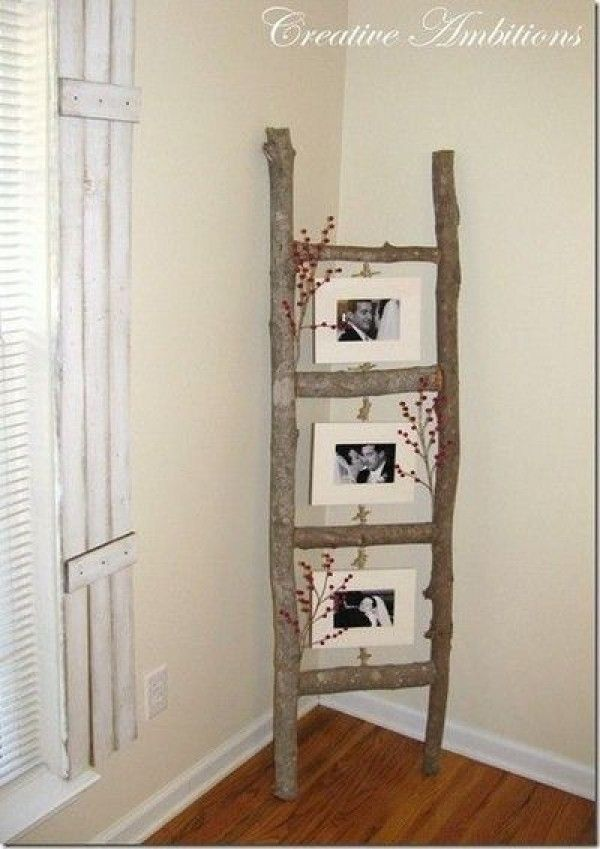 A ladder for holding framed pictures. Made of tree branches.