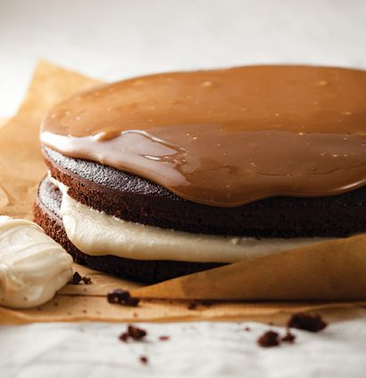 Chocolate cake with caramel icing and fudge sauce