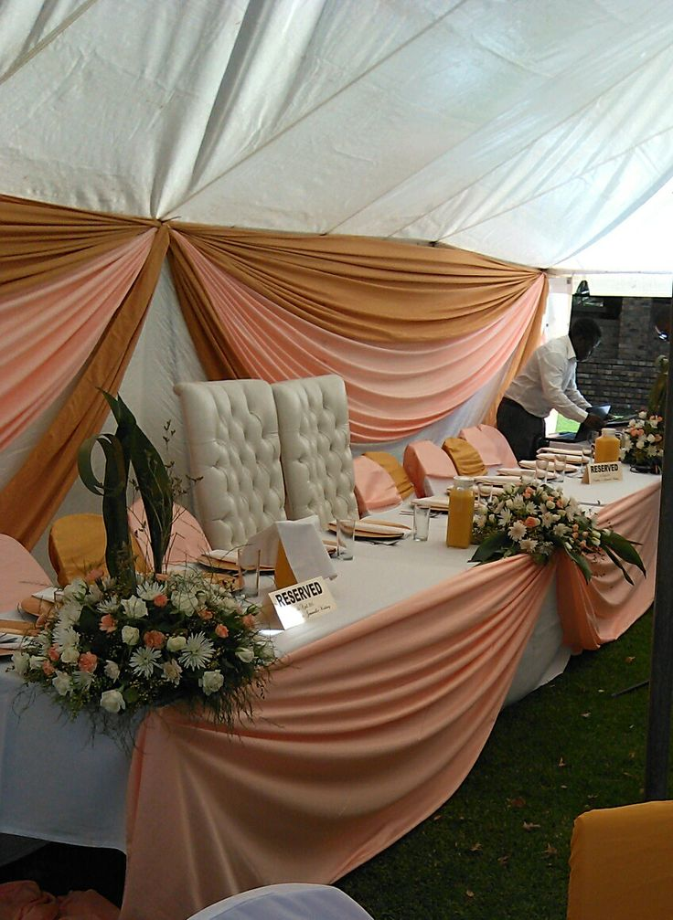 Tent draping in front and behind main table