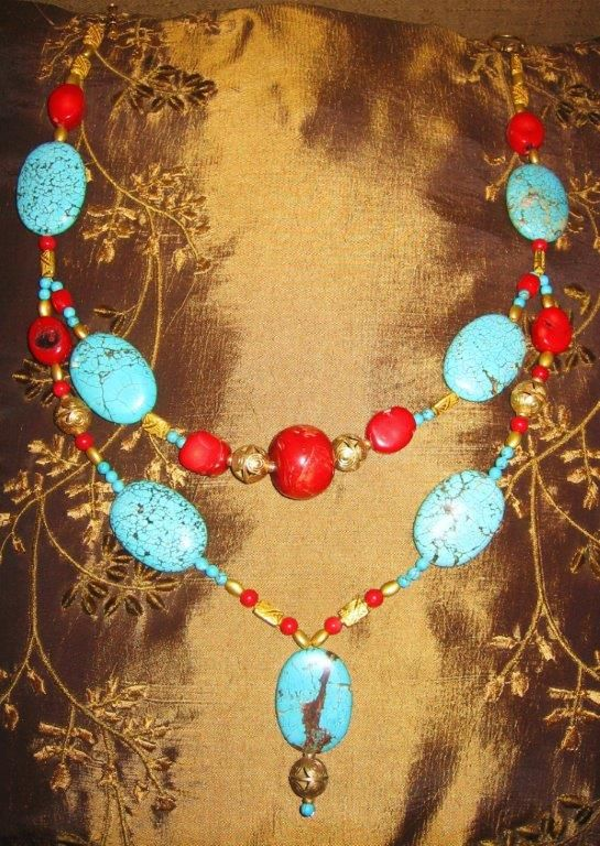 Necklace of coral, turquoise and gold plated beads. Created by James Phillips.