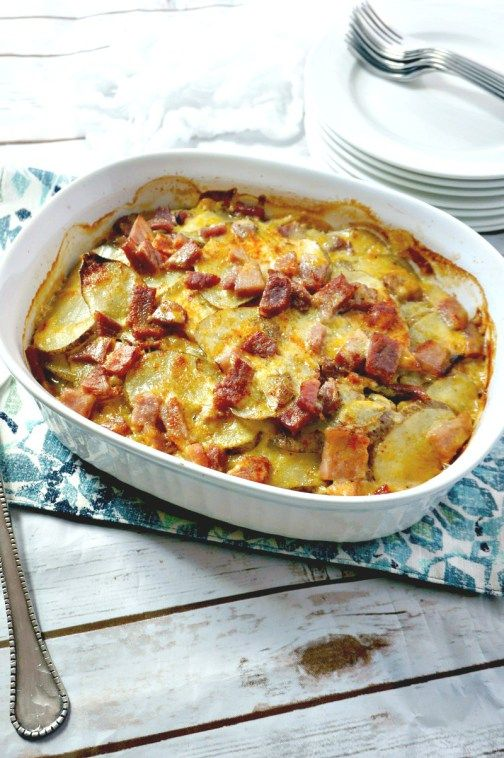 Cheesy Ham and Scalloped Potatoes: Leftover ham shines in a simple gratin made with sliced potatoes and a homemade sharp cheddar cheese sauce.