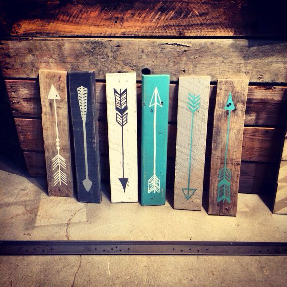 Reclaimed wood arrows. I'd use green for our living room.