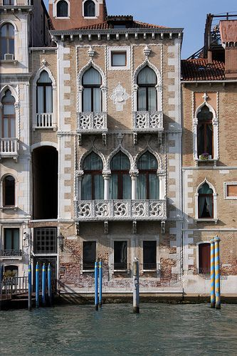 Houses in Venice, Italy are noted for their elegant facades facing the water. In this city without roads, guests usually entered by boat. The Gothic style was popular in the 13th to mid 15th centuries. Houses of this period are noted for their pointed arches, carved window heads and ornate capitals. AIMG_4825