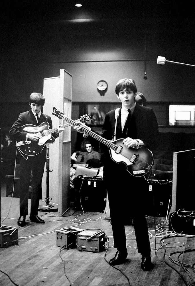 Paul McCartney and George Harrison in the studio