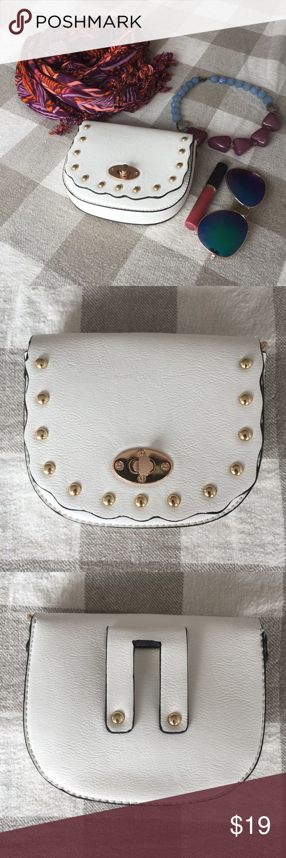 "NWOT Small Cute Crossbody Bag with Golden Drops Very cute little white crossbody bag 5.5""x6.3"" that will be a great addition to your wardrobe. Be it a night out or a trip to Europe, this little piece will nicely compliment your outfit. It can also be worn on a belt. Bags Crossbody Bags"