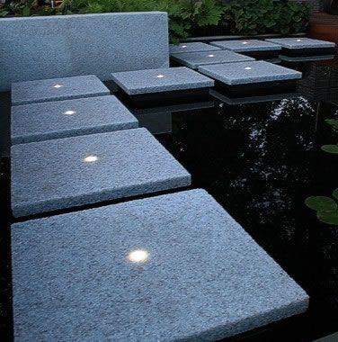 Solar lighting in slab tiles, great for a lit walkway