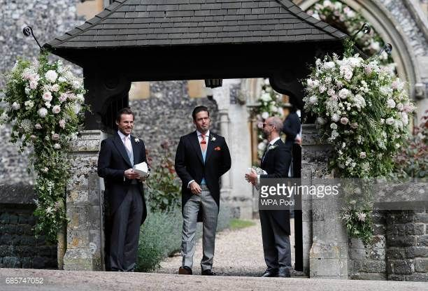 Spencer Matthews center stands at the entrance of St Mark's Church in for the wedding of Pippa Middleton and his brother James Matthews on May 20...