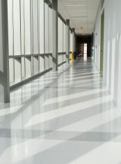 Light at the end of long hallway stock photo