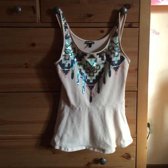 Express embellished tank top This beautiful tank top glistens in the light and it's perfect to wear with the nude cardigan or a nice black blazer. *This piece has been worn before* Express Tops Tank Tops