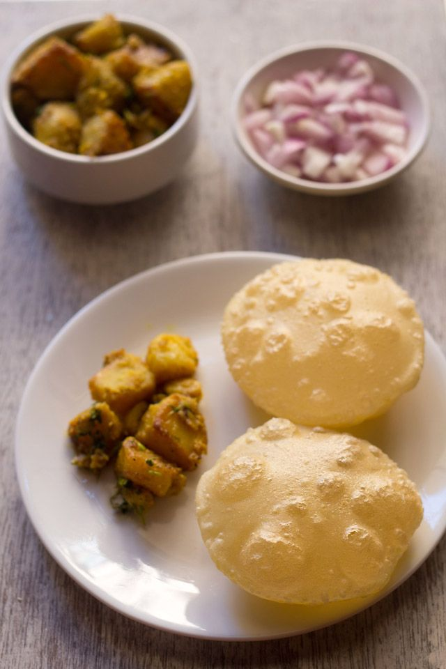 bengali luchi recipe for durga puja celebrations. deep fried and much loved bengali bread. made with all purpose flour, salt and ghee/oil.