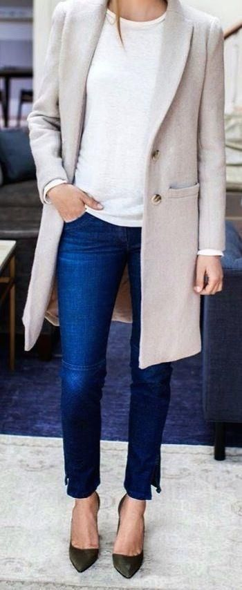 Gray coat over white tee and blue jeans.
