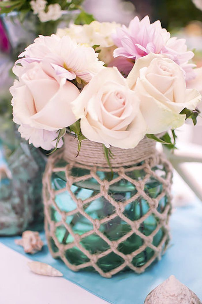 Flower centerpieces from Littlest Mermaid 1st Birthday Party at Kara's Party Ideas. See more at http://karaspartyideas.com! #partyflowers #undertheseaflowers Ideal for a mermaid or under the sea themed birthday party, baby shower or bridal shower