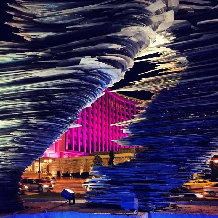 "One of those beautiful photos of LIFO (official) Athens! The Hilton Hotel lighted in pink, behind the ""Runner-sculpture""of Costas Varotsos."