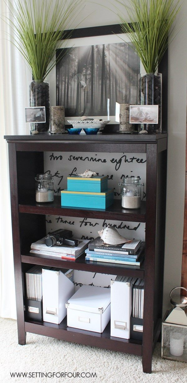 Perk up your bookshelf! DIY Bookcase Hack: See this beautiful book shelf makeover with removable fabric lined backing.
