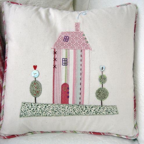 Applique house cushion.