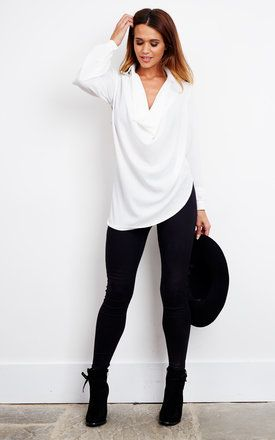 In a demure ivory colour, this long sleeve blouse is a must have. Ideal for the office over a pair of slacks and flats, over a pair of leather pants and heels for a nighttime feel or simply tucked in a pencil skirt for whenever.