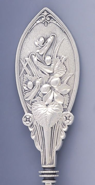 Pattern Detail: Whiting aesthetic period sterling silver sugar spoon, with shell form bowl and unusual floral motif, c1870 (bubbleking)