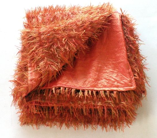 'Cinnamon delight' throw. Burnt orange shag fabric with gold lurex threads, backed in faux silk.