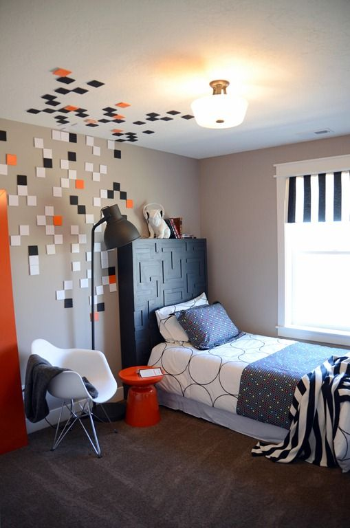Such a cool concept and execution. Pac Man inspired boy's room.  Old school Pac Man grid headboard.
