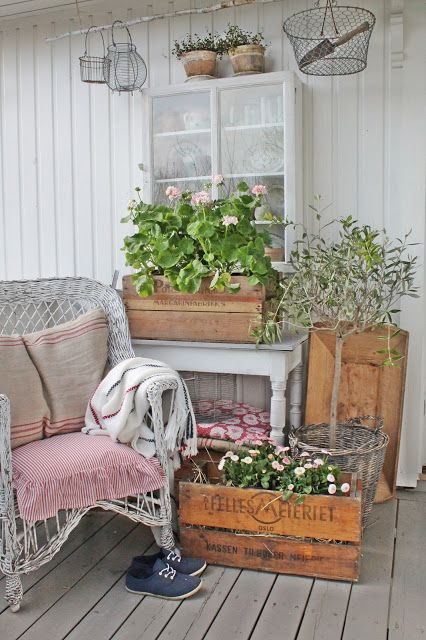 Summer farmhouse porch with reclaimed wood, flowers, and vintage finds!