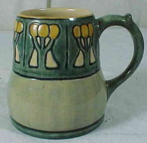 Wow, this Newcomb College Mug signed by Marie de Hoa Le Blanc sold for $1941 The mug measures 4 1/8″  tall and is marked with the Newcomb College NC logo and is also marked PP40 and the artist Marie de Hoa Le Blanc's signature.  The mug was listed with no damage.