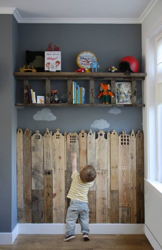 cool reclaimed wood on wall!  Lol.  But this poor little dude can't reach any of his stuff!   But it's still a cute idea!
