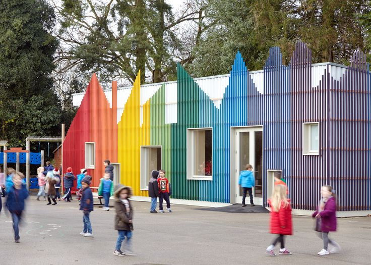 A rainbow-coloured facade shaped like a row of houses fronts this school dining hall in England, designed by De Rosee Sa and PMR to reference Roald Dahl