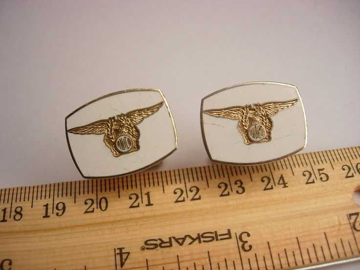 """This is a pair of Vintage American National Insurance Company Cufflinks. These ANICO cufflinks have an Eagle on the background of White Enamel and the ANICO Seal. They are in good vintage condition and measure 5/8"""" by 3/4"""". Marked Attleboro on the backside. cl"""