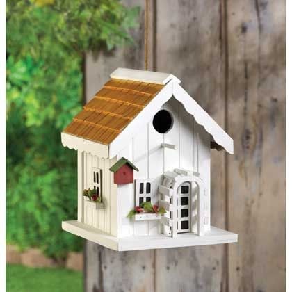 Bright and cheery, just like the song of the lucky bird that gets to call this sweet house home! A perfect complement to your yard, this charming birdhouse features tiny window boxes bursting with tin