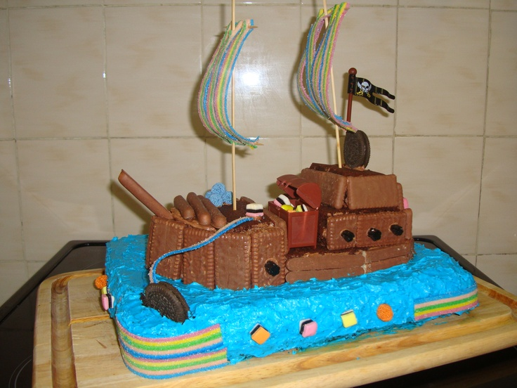 My attempt at a Pirate Birthday Cake - if you cannot ice just stick chocolate fingers, biscuits and sweets to it!