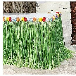 "Decorate sides of the table with ""grass skirts"" by cutting green garbage bags into thin strips"