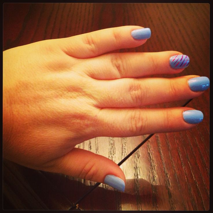 My moms nails! The blue is from Essie! It's called bikini so teeny! And the little lines are just different stripers!