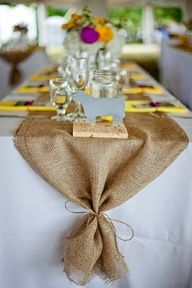 Gonna do burlap like this on the tables with the peacock feather and wildflower centerpieces in mason jars!