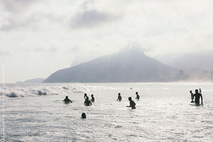 Silhouette of people on the beach. Ipanema beach in rio de Janeiro, Brazil by Alejandro Moreno de Carlos