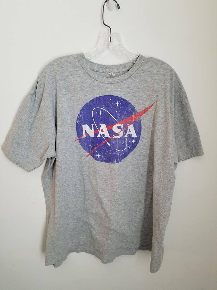 Check out all the vintage clothing at Dear Alice Co. !!! This NASA tee is a super cool addition to any t-shirt collectors list! #logoshirts #NASA #tshirt #gray #vintagenasatshirt #vintageshop
