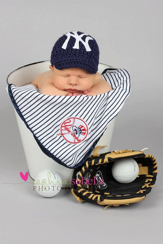 yankee baby. I would do this and have some one crotchet a Oakland Raiders beanie and put a football instead of glove and mitt. Future Reference.