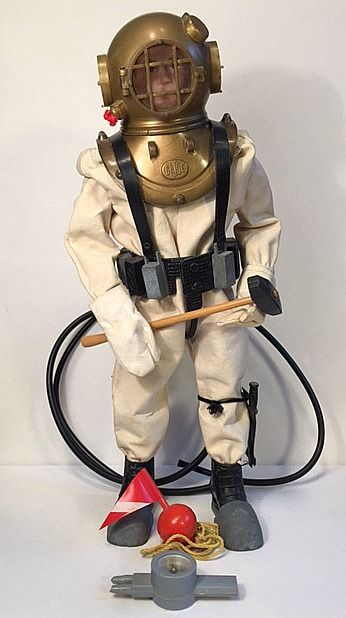 US Navy #7620 Deep Sea Diver.  (A childhood favorite)  Set came with a rubberized dice suit, Dive helmet with face plate, helmet mounting plate, dive gloves, dive boots, lead shoe weights, oxygen pump with compass (child's mouth piece to blow air into the helmet when submerged), two rubber lines, marker buoy, dive knife and scabbard, and sledge hammer,