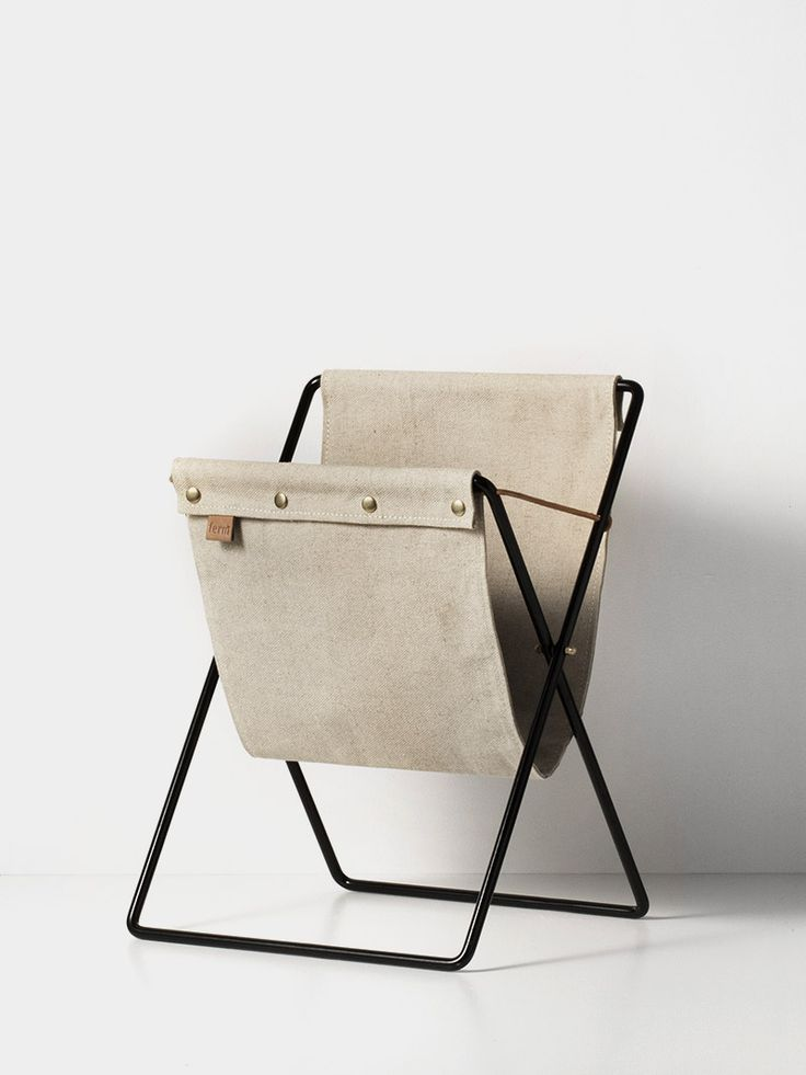 ferm LIVING's magazine rack fuses a vintage aesthetic with a modern mix of materials. Durable canvas holder - powder coated metal. Fast delivery