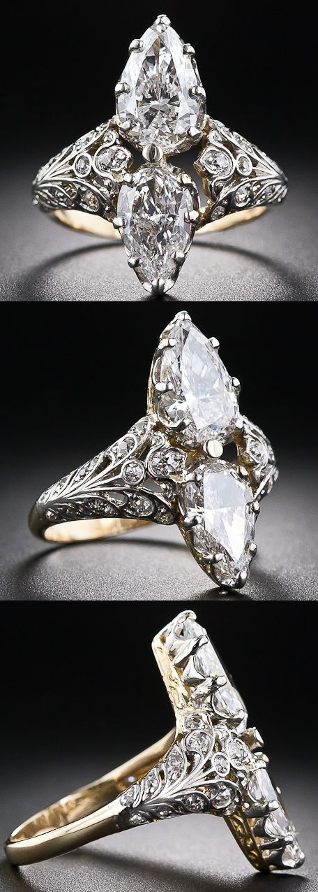Edwardian twin-stone pear-shape diamond ring. This resplendent diamond dinner ring, dating back to the first decades of the 20th century, scintillates with a bright-white and shining pair of pear-shaped diamonds set back-to-back atop a finely handcrafted setting rendered in platinum over 18 karat gold, accented with tiny old-cut diamonds. The dazzling pair of pear-shaped diamonds respectively weigh 1.20 carats and .80 carats ( 2.00 carats total).  Via Diamonds in the Library.: