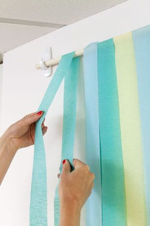 Wooden dowel & reusable command strips to hang your photobooth backdrop. Brilliant!