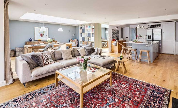 Large open plan living space with red persian rug