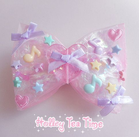 "☆ A holographic iridescent dream*¨*•.¸¸⋆*✩  ☆ cute hair bow and pin  ☆ made from magical glitter tulle, holographic film cellophane and iridescent bows  ☆ size: 12 cm x 9 cm (4.7"" x 3.5"")  ☆ cute satin ribbon bows and hearts ☆ iridescent fairy bows and stars  ☆ heart and bow glued in middl..."