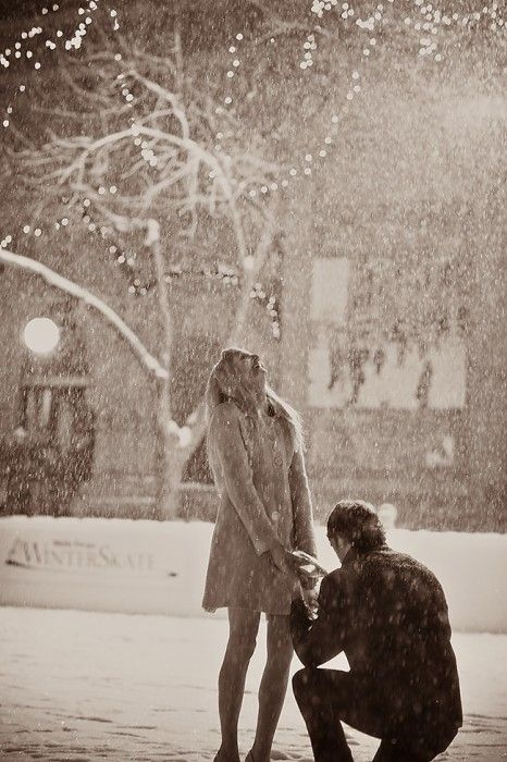 Creative Christmas Proposal Ideas: Take advantage of flurries, and take her into the cold to warm her heart. If it doesn't snow where you are (hello local grooms to be), get creative. A man-made snow shower proves even more that you'll do whatever it takes to make her dream come true.