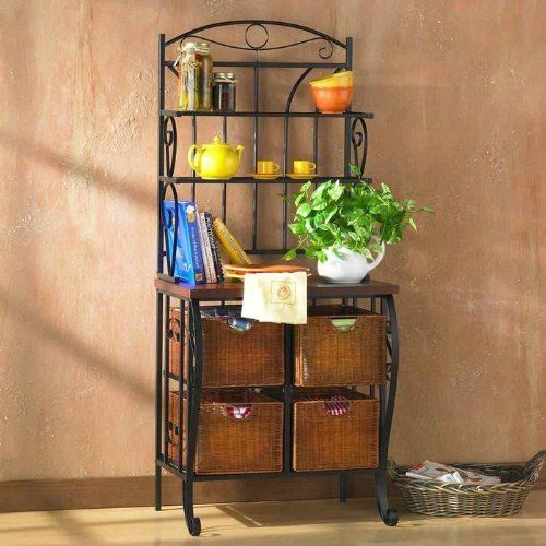 """Iron/Wicker Bakers Rack by Unknown. $199.99. 28"""" x 19.5"""" x 65.25"""" Tall. Oak laminate counter. 4 brown wicker baskets. Iron/Wicker Bakers Rack. Simple and stylish, this baker's rack solves the storage issues of the kitchen. Take advantage of the spacious four wicker drawers measuring 14"""" deep, 11"""" wide, and 8.5"""" tall to store your dishtowels, pots, pans, cookbooks, and more. The shelves are perfect for showing off fancy plates and cups. The 30"""" tall cherry counter is 17"""" de..."""