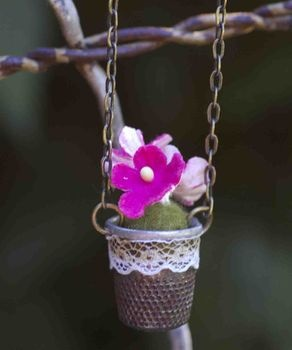 Cute for garden to hang on small branch .