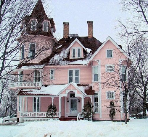 Restored old Victorian.  Pretty in pink and snow. Imagine the character of rooms in that house.
