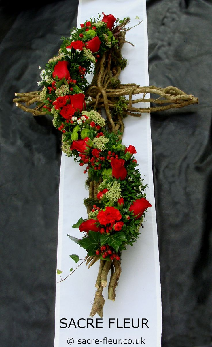Funeral tribute made from ivy caging and dressed in a floral garland; ivy collected and prepared from our own woodland. I first designed this cross tribute in 2008; this red and green colour scheme remains one of the my favourite interpretations of my design ever.
