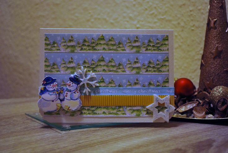 Handmade Christmas card with cute snowmen