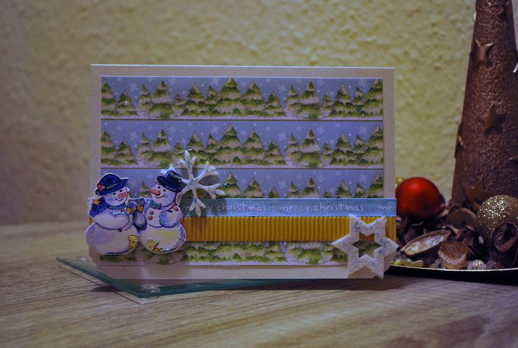 Handmade Christmas card with cute snowmen