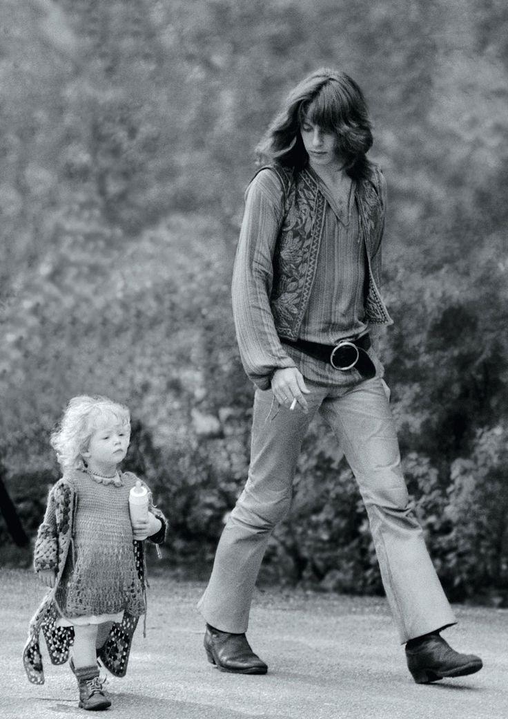 A hippie walking with his kid in Vondelpark, Amsterdam in 1968